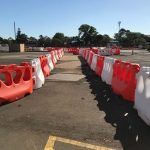 Is it better to buy or hire water filled barriers?